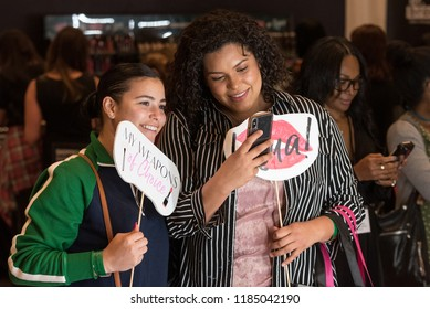 Orlando, Florida / USA - September 15, 2018: Two Attractive Young Women Taking a Selfie with a Phone at The Makeup Show in Orlando, FL