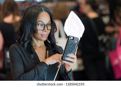 Orlando, Florida / USA - September 15, 2018: Young Woman Taking a Selfie with Her iPhone  at The Makeup Show in Orlando, FL