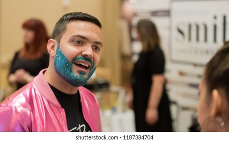 Orlando, Florida / USA - September 15, 2018: Man with a Blue Beard with Sparkles at The Makeup Show in Orlando, FL