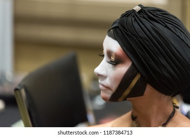 Orlando, Florida / USA - September 15, 2018: Profile Portrait of a Female Model with Creative Makeup Applied by a Makeup Artist at The Makeup Show in Orlando, FL