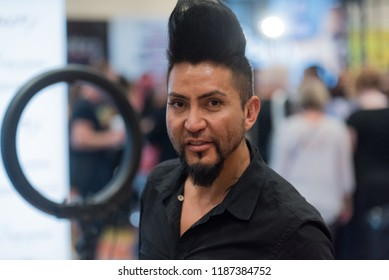 Orlando, Florida / USA - September 15, 2018: Man with a Stylish Hairstyle at The Makeup Show in Orlando, FL
