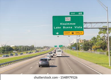 Orlando, Florida / USA - September 4th 2019: An American road sign mounted on an overhead gantry on the I4 freeway, points the way to Kissimmee and Lake Buena Vista in the southern state of Florida.