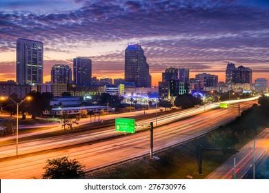 Orlando, Florida, USA skyline over the highway.
