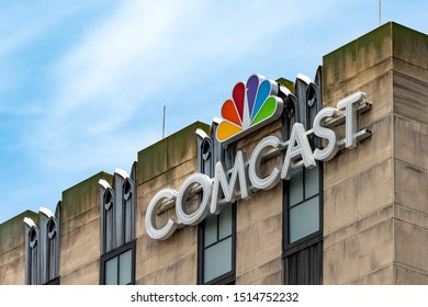 Orlando, Florida, USA-July 16, 2019: Low angle view of a Comcast sign or logo on a building wall. Comcast is the second-largest broadcasting and cable television company in the world by revenue