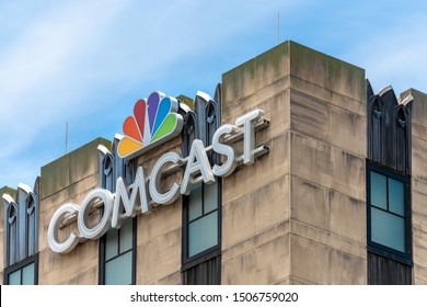 Orlando, Florida, USA-July 17, 2019: Sign or logo of Comcast Studios seen on top of a building. Comcast Corporation is an American telecommunications conglomerate headquartered in Philadelphia