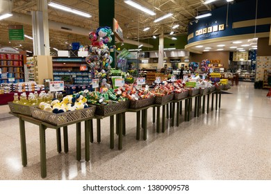 Orlando, FL/USA - 04/24/19: BOGO or buy one get one free sale display tables at a Publix grocery store.