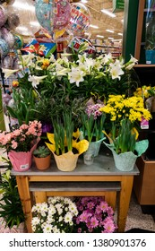 Orlando, FL/USA - 04/24/19: Spring Flowers in pots and balloons for sale at Publix grocery store in Orlando, Florida waiting to be purchased by customers.