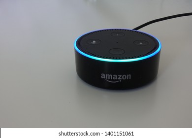 Orlando, FL/USA-5/17/19: Amazon Alexa, known simply as Alexa, is a virtual assistant developed by Amazon, first used in the Echo and the Echo Dot smart speakers developed by Amazon Lab126. Side angle.