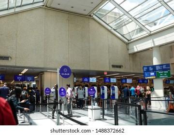 Orlando, FL/USA-8/22/19: Airport security at a busy international airport with Clear, TSA precheck and TSA standard screening.