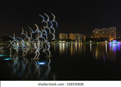 Orlando Lake Eola in the night and sculpture of colored birds