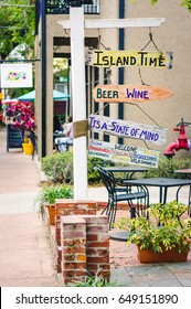 Orlando, US - March 12, 2017: Hip and colourful signpost outside a cafe bar in the historic Thornton Park area of downtown Orlando.