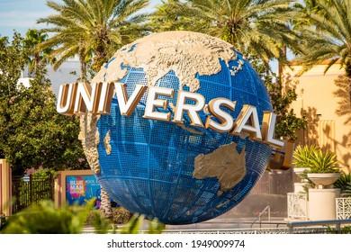 Orlando, USA - Feb. 12, 2021: Orlando Universal Studios globe fountain monument sign at the entrance to the park