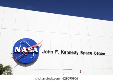 ORLANDO, USA - JULY 25, 2011: facade of main entrance for tourists with John F. Kennedy Space Center and NASA emblem in Orlando.