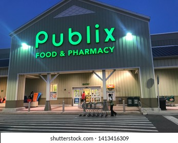Orlando, USA, June 4, 2019: Publix food & pharmacy, a beautiful facade with green paint and straw, a supermarket and pharmacy, bright in bright green, across a wide range of pedestrians.