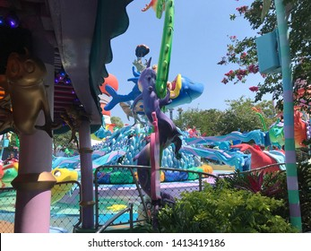 Orlando, USA, June 5, 2019: Water park, leisure center attractions and water-based amusements, with very colorful toys of sea elements such as shark, dolphin, Disney