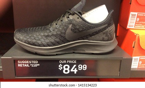 Orlando, USA, June 7, 2019: The Nike Air Zoom Pegasus 35, lightweight, stylish, women's sports shoe designed with shock absorbers, alongside red boxes