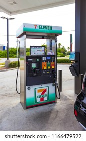 Orlando, USA - May 8, 2018: Filling nozzles at 7-Eleven gas station at Orlando, USA on May 8, 2018. 7-Eleven is an multinational oil and gas company and service stations