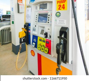 Orlando, USA - May 8, 2018: Filling nozzles at a Shell gas station at Orlando, USA on May 8, 2018. Shell is an Anglo-Dutch multinational oil and gas company headquartered in the Netherlands.