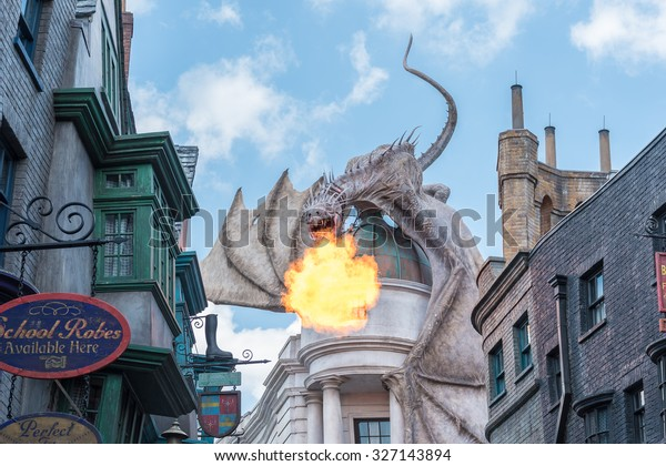 ORLANDO, USA - SEPTEMBER 02, 2015: Gringotts Bank Dragon breathing fire The Wizarding World Of Harry Potter at Universal Studios Orlando. Universal Studios Orlando is a theme park in Orlando, Florida.