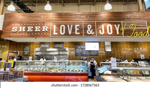 Orlando,FL/USA -5/3/20:  The deli counter of a Whole Foods Market grocery store with colorful sliced meat and cheese and freshly prepared food ready to be purchased by consumers.