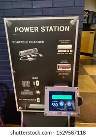 Orlando,FL/USA-10/5/19: FuelRods power station kiosk at a theme park.  FuelRods is a reusable, portable charging system for mobile devices.