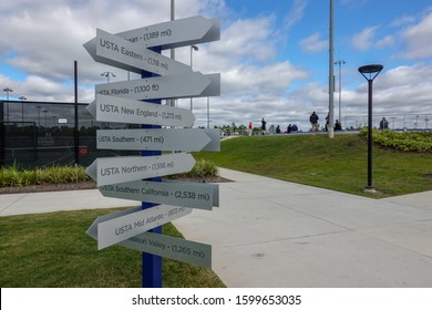 Orlando,FL/USA-11/16/19:  A post with signs and distance to the United States Tennis Association USTA National Campus in Orlando, Florida to the other USTA.