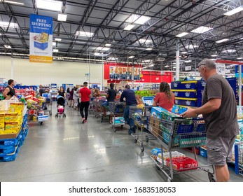 Orlando,FL/USA-3/14/20: Customers standing in long lines waiting to check out their groceries at a Sams Club in Orlando, Florida due to the hoarding of food and supplies during the coronavirus COVID19