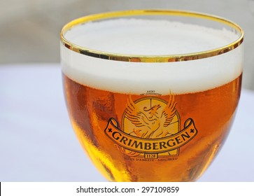 ORLEANS, FRANCE - JULY 4, 2015: The traditional Belgian blond abbey beer brand Grimbergen with the phoenix logo is very popular in Orleans and other parts of France