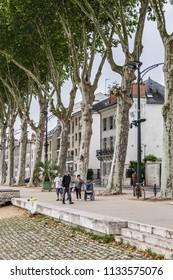 ORLEANS, FRANCE - JUNE 10, 2018: Quai du Chatelet - long promenade along water's edge of Loire river in Orleans city. Orleans is capital of the Loiret department and of the Centre-Val de Loire region.