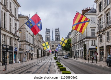 ORLEANS, FRANCE - JUNE 10, 2018: View of the famous street of Joan of Arc decorated with ancient flags in central Orleans.