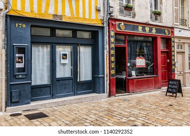 ORLEANS, FRANCE - JUNE 10, 2018: View of street Rue de Bourgogne in central Orleans. Rue de Bourgogne is one of most famous in Orleans, restaurants sit alongside small shops and friendly bars.