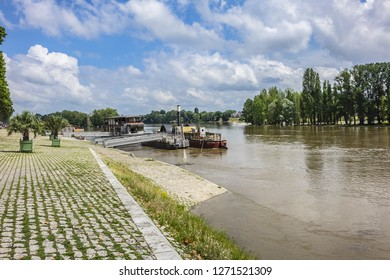 ORLEANS, FRANCE - JUNE 10, 2018: Quai du Chatelet - long promenade along water's edge of Loire river in Orleans city. Orleans is capital of the Loiret department and of the Centre-Val de Loire region.