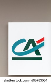 Orleans, France - March 19, 2017: Credit Agricole logo on a wall. Credit Agricole is a French network of cooperative and mutual banks comprising the 39 Credit Agricole Regional Bank