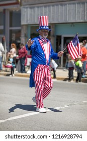 Orleans, Indiana, USA - April 28, 2018: The Orleans DogWood Festival and Parade, Man dress up as Uncle Sam waving the American Flag