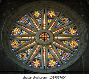 Orleans, Loire Valley, France - June 1, 2018: Colorful stained glass rose window inside the Cathedral of the Holy Cross.