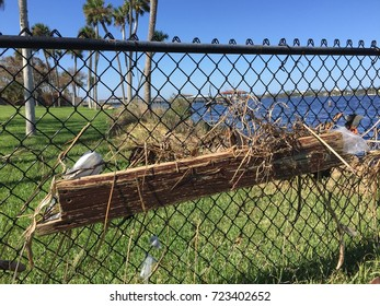 ORMOND BEACH, FLORIDA/ USA – SEPTEMBER 27, 2017: Weeks after Hurricane Irma passes through, a dock plank is still embedded in a fence.