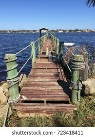 ORMOND BEACH, FLORIDA/ USA – SEPTEMBER 27, 2017: Weeks after Hurricane Irma passes through, a damaged dock sits on the Intracoastal waterway in Florida.