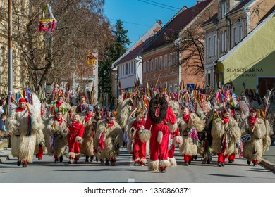 """ORMOZ, SLOVENIA - MARCH 5th 2019: Slovene national masks """"kurent"""" dancing on the streets of Ormoz at the carnival time"""