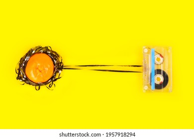 An ornage entangled by the magnetic tape of a casette. A metaphorical statement spoken via two objects through minimalistic still-life photography at a studio.