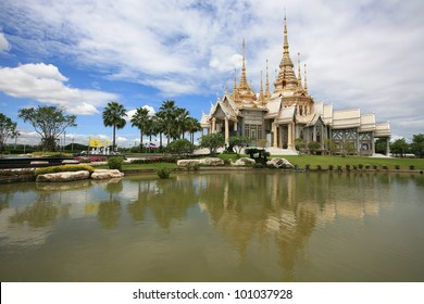 Ornament: beautiful landscape of White Thai Temple near the pond with reflection against blue sky at Sorapong's Temple in Nakhon Ratchasima Province, Thailand