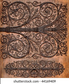Ornament twirly metal fittings on ancient medieval door