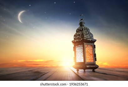 Ornamental Arabic lantern with burning candle glowing at night. Festive greeting card, invitation for Muslim holy month Ramadan Kareem. - Shutterstock ID 1936253671