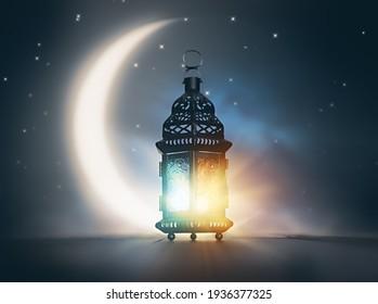 Ornamental Arabic lantern with burning candle glowing at night. Festive greeting card, invitation for Muslim holy month Ramadan Kareem. - Shutterstock ID 1936377325
