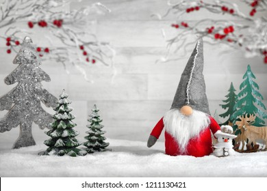 Ornamental arrangement for winter and Christmas, with a Santa puppet