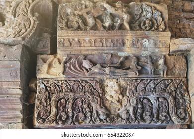 Ornamental carved stone lintel showing Vishnu reclining on the serpent Ananta Sesha (Narai Bantomsin) at Ku Phra Kona, group of Khmer prangs or pagodas, Roi Et, Thailand