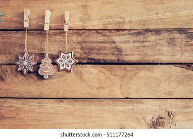 Ornamental christmas decoration hanging on wooden for christmas background with space