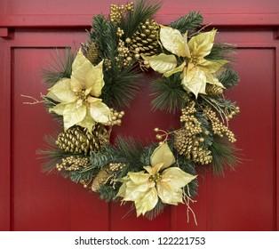 Ornamental Christmas wreath on red door