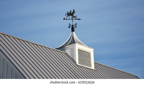 ornamental compass sign on top of roof