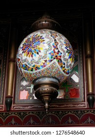 Ornamental lamp with colorful mosaic inlay and brass fittings