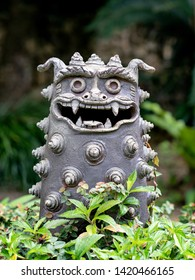 An ornamental Male Lion Dog with open mouth to guard from evil spirits
